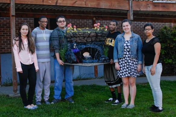 Kenai Brazier, Courtney Cox, Kara Hatcher, Justin Kon, Jalal Lawrence, Elizabeth Abramchuk pose with their diorama