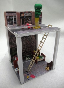 A mockup of the diorama from Thomas Jefferson High School. It features Dino Guy as the Phantom, a character who lives underground in the sewer system and comes up at night to raid the candy store.