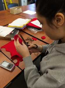 Students Belen Contreras, Angel Zuniga and Jorge Zuniga from Lincoln High School are developing new skills in sewing and textiles to make parts of their diorama.