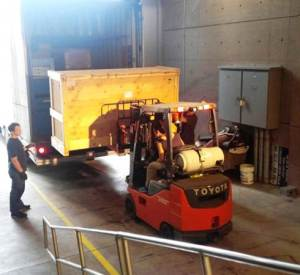Museum of Glass crew off-loading crates for an exhibition.