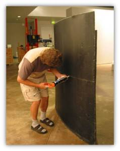 Museum of Glass crew member securing segments of work by Stanislav Libenský and Jaroslava Brychtová, 2002.