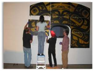 Museum of Glass crew installing Preston Singletary's Clan House, 2008, onto a specially engineered Plexiglas™ support. Collection of Museum of Glass.