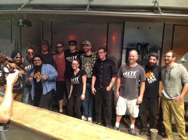 Tacoma Glassblowing Studio and Hilltop Artists teams after making the Great Glass Pumpkin.