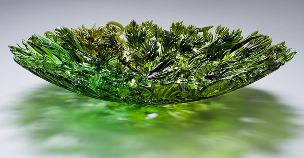 Amber Cowan; Bottle Bowl, 2012; Flameworked and fused recycled wine bottles; 15 x 15 x 2 inches; Photo courtesy of the artist.
