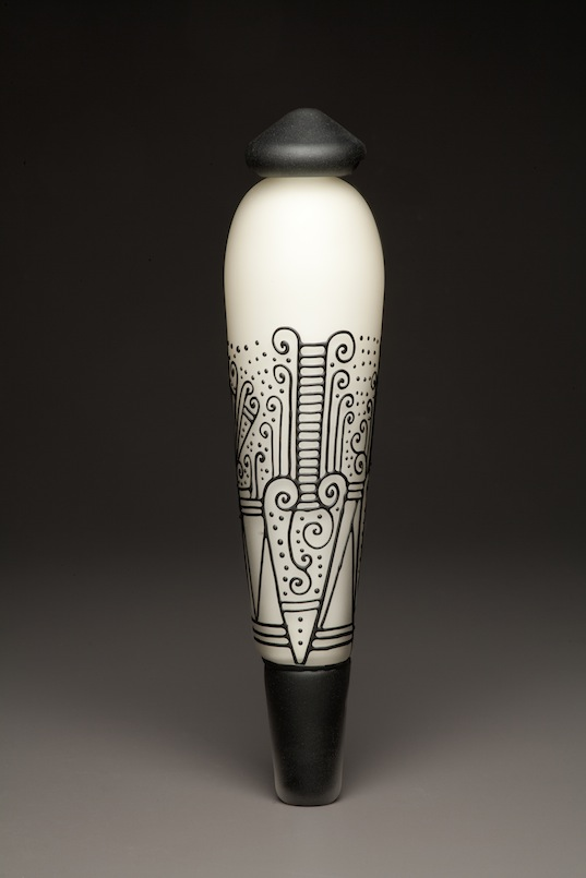 Ali VandeGrift and Brennan Kasperzak; Ivory and Black Pendulum, 2015; Blown vessel, cane drawn, and sandblasted; 17 x 4 x 4 inches; Photo by Mike Seidl.